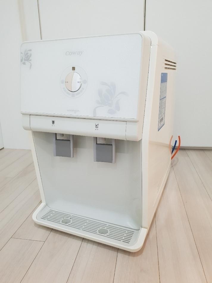 코웨이 정수기 (냉, 정수기)  +물 빼는 호스2개