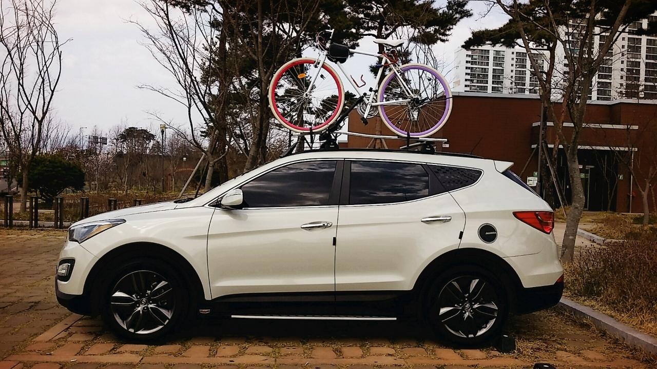툴레가로바와 자전거 캐리어